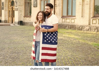 Emigration from the native country. Happy couple of emigrants on independence day of the us. Emigration for better opportunities. International emigration. Emigration and new life in the usa.