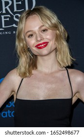 """Emily Alyn Lind arrives at the """"Sacred Lies: The Singing Bones"""", Facebook Watch's premiere screening, at The Hollywood Roosevelt Hotel, Feb.19, 2020 in Los Angeles, CA."""