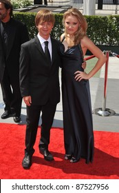 Emily Osment & Jason Earles at the 2009 Creative Arts Emmy Awards at the Nokia Theatre L.A. Live in Downtown Los Angeles. September 12, 2009  Los Angeles, CA Picture: Paul Smith / Featureflash