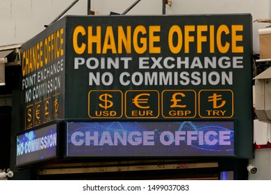 "Eminonu, Istanbul / Turkey - September 1 2019: Generic led board box with currency signs and ""CHANGE OFFICE"" text. USD, EUR, GBP and TRY currency signs for Dolar, Euro, Pound and Turkish Lira."