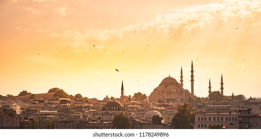 Eminonu Port with Ships and Suleymaniye Mosque in the Fatih district at Golden Horn River before sunset, Istanbul, Turkey. Travel concept and Sea front landscape of Istanbul historical part.