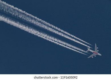 An Emirates Airbus A380 airliner is overflying Greece in blue sky, flying from Rome Fiumicino Airport in Italy to Dubai International DXB airport, UAE. Thessaloniki, Greece - 14 September 2018
