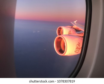 Emirates Airbus A380, Dec 5 2017, Melbourne International Airport, Australia, aerial view from the aeroplane window overlooking twin engines during sunrise