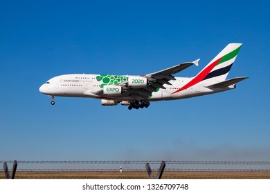 Emirates Airbus A380 with registration  A6-EOJ and EXPO 2020 paint landing in blue sky at Dusseldorf Airport, connecting Germany to Dubai DXB /OMDB, UAE . Dusseldorf, Germany - February 27, 2019