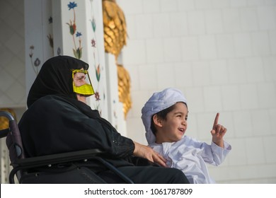 emirates kid with his grand mother