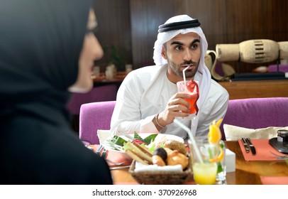 Emirati arab couple dining in a restaurant in Dubai