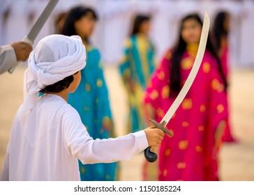 Emirati Boy dancing traditional UAE dance