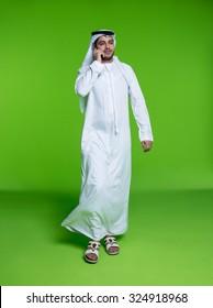Emirati businessman talking on mobile