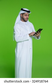 Emirati businessman using digital tablet