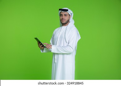 Emirati businessman using digital tablet
