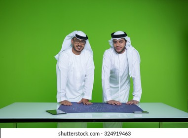 Emirati businessmen with blueprint