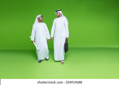 Emirati businessmen with blueprint and bag