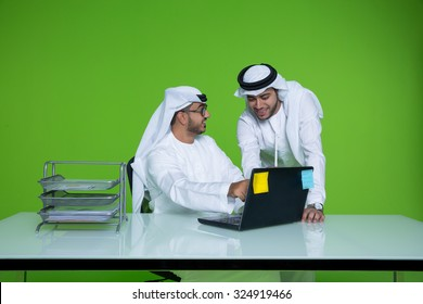 Emirati businessmen discussing
