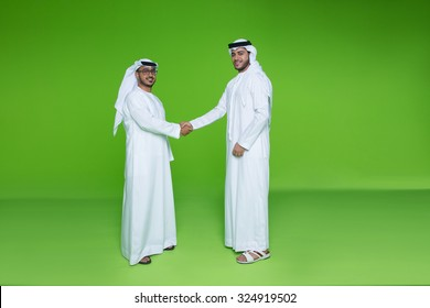 Emirati businessmen shaking hands