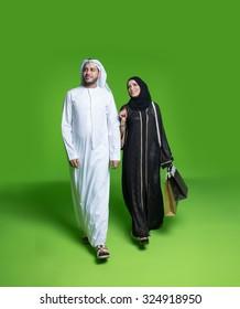 Emirati couple carrying shopping bags