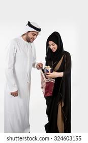 Emirati couple with gift box