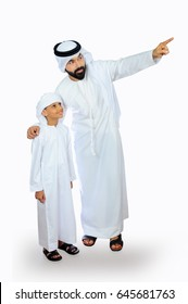 Emirati Father and Son looking with Curiosity