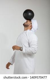 Emirati man playing with football.