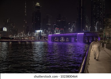 An Emirati man takes a stroll along the Dubai creek. Dubai, United Arab Emirates September 4, 2017.
