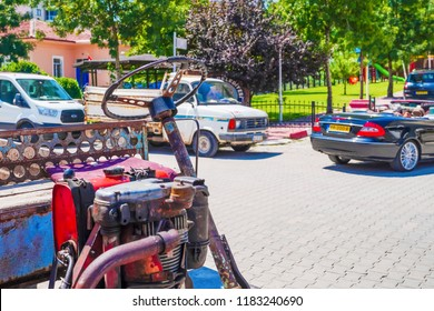 Emirdag, Afyonkarahisar / Turkey - August 07 2018: View of one of Emirdag street, farming truck (taktak, patpat) and new sport car in background, concept of new and old together