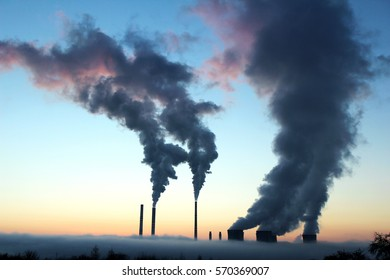 emission from coal power plant during the sunset