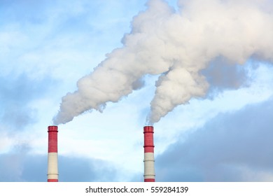 Emissions to air by smoke coming out of factory chimneys.