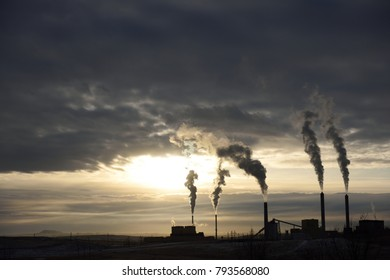 Emissions rising from a coal-fired power plant at sunset near Gillette, Wyoming / USA.