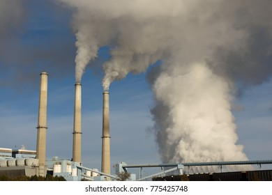 Emissions rising from the smoke stacks of a coal-fired power plant station near Wheatland, Wyoming / USA.