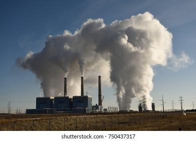 Emissions rising from the smoke stacks and cooling tower of a coal fired power plant station near Wheatland, Wyoming / USA.