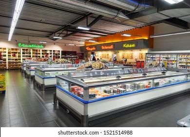 EMLICHHEIM, GERMANY - APRIL 2019: Interior of a German supermarket. Frozen food department of a K+K, Klaas & Kock supermarket