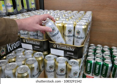 EMLICHHEIM, GERMANY - APRIL 26, 2018: Stacked Krombacher cans of beer in a supermarket. Krombacher is one of the largest privately owned breweries in Germany.