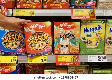 EMLICHHEIM, GERMANY - OCTOBER 5, 2018: Shelves with Kellogg's and Nestlé brand breakfast products for kids in a German REWE supermarket.