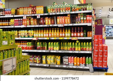 EMLICHHEIM, GERMANY - OCTOBER 5, 2018:  Aisle with assortment fruit juices in a German REWE supermarket.