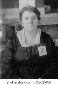 Emma Goldman, wearing '38' tag while government custody, ca. 1917-20. As a resident alien writer on anarchist philosophy, and radical politics, she was jailed in 1917 for advocating draft resistance.