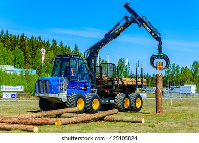 Emmaboda, Sweden - May 13, 2016: Outdoor forest and tractor fair. Rottne F13D forwarder is used in the junior Swedish championship for young drivers. Driver is Rasmus Isaksson.