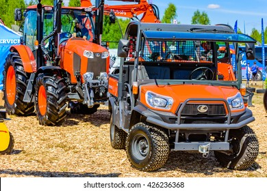 Emmaboda, Sweden - May 13, 2016: Forest and tractor (Skog och traktor) fair. Kubota 4WD utility vehicle RTV x900 with tractor in background.