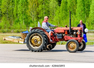 Emmaboda, Sweden - May 14, 2016: Forest and tractor (Skog och traktor) fair. Vintage classic tractors on parade. Here a red BM 425 Terrier of unknown year.