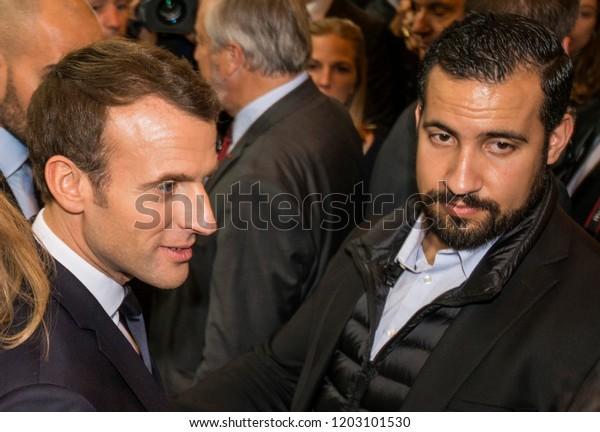 Emmanuel Macron (L) with Alexandre Benalla (R) during the visit of  the Salon du Livre international book fair at the Porte de Versailles exhibition center in Paris, France, on Friday, March 15, 2018.