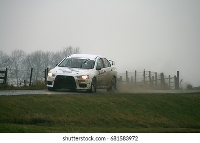 Emmeloord, Netherlands - March 20: Driver Hans Stacey and copilot Harold Mosman in a Mitsubishi Lancer Evo 10 in Tank S Rally, on March 20, 2010 around Emmeloord, the Netherlands.