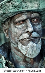 Emmen, Drenthe, Nederland, October 29, 2017, Living Statues, portrait of living statue Sancho Panza  with beard, moustache and hat.