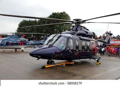 "EMMEN, SWITZERLAND - JULY 24: Company SwissJet presents its fleet of modern of helicopters at the Airshow ""100 years Swiss aviation"" July 24, 2010 in Emmen, Switzerland."
