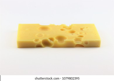 An Emmenthal cheese slice on white background