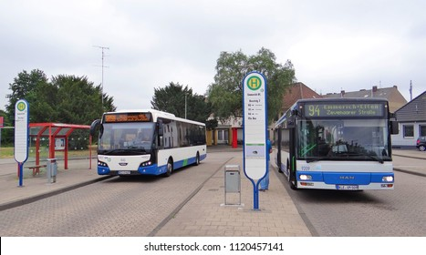 Emmerich / Germany - June 19 2018: Two blue / white public transport buses of the NIAG at the bus station of Emmerich. (A VDL Citea bus and a MAN bus)