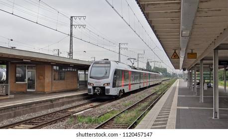 Emmerich / Germany - June 19 2018: The Rhein-IJssel-Express of Abellio with a Stadler FLIRT 3 train at the nearly abandoned railway station of Emmerich