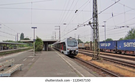 Emmerich / Germany - June 19 2018: An Abellio train from the Netherlands to Dusseldorf in Germany at the railway station of Emmerich with at the right a freight train.