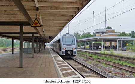 Emmerich / Germany - June 19 2018: The Rhein IJssel Express of Abellio with a Stadler FLIRT 3 train at the nearly abandoned and empty railway station of Emmerich
