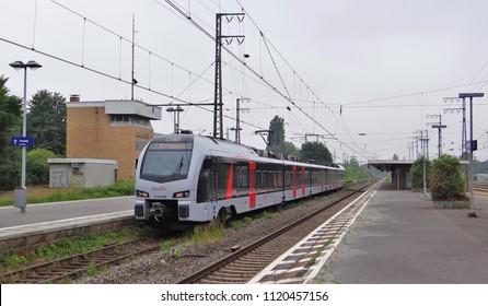 Emmerich / Germany - June 19 2018: An Abellio FLIRT 3 train as RE 19 from the railway station of Arnhem to Dusseldorf at the platform of Emmerich