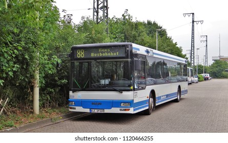 Emmerich / Germany - June 19 2018: A blue / white MAN public transport bus of the NIAG at the bus buffer in Emmerich with a break (Bus line 88 to Rees bahnhof)