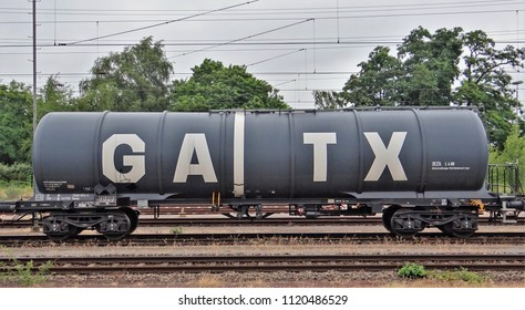 Emmerich / Germany - June 6 2018: A side view of a grey tanker railway (railroad) freight car / wagon of GATX.