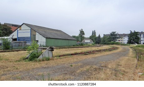 Emmerich / Netherlands - June 6 2018: Old, empty en desolate industry terrain with some railway tracks with a buffer.